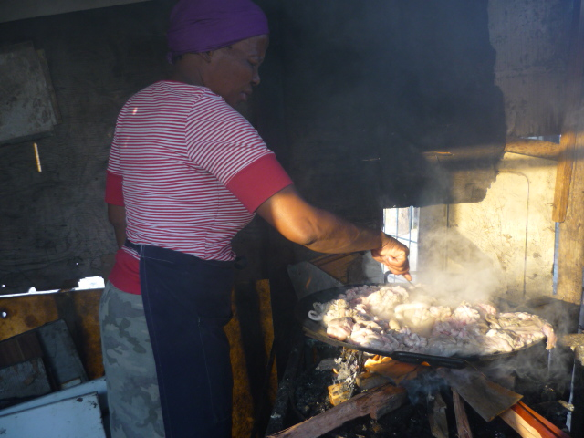 Cooking sheep innards, township, Cape Town, South Africa