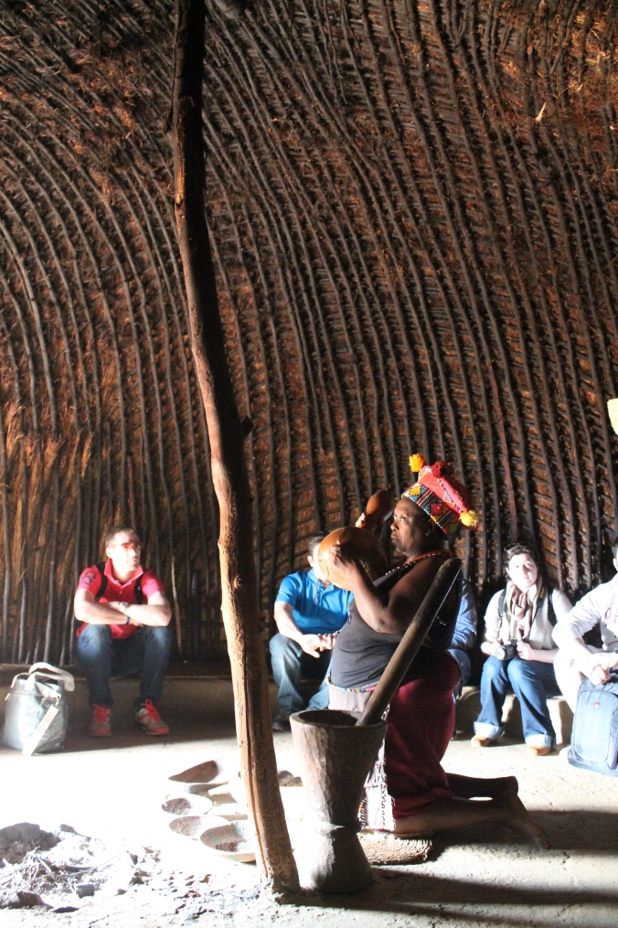 A Zulu woman demonstrating in recreated cooking hut, South Africa