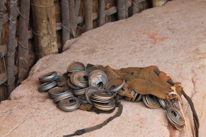 The jinglers that dancers wear on their ankles are made from old soda can lids, South Africa